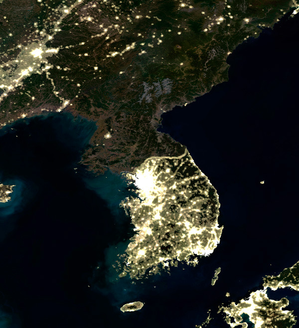 Kim Jong Il's dark legacy demonstrated in a satellite image. It's one of the darkest places on Earth, and I'm not just talking about its lack of electricity. What will we see here in ten years? Twenty? (via Short Sharp Science)