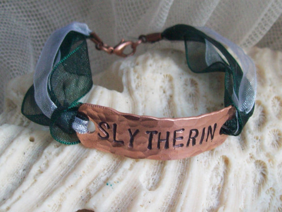 Harry Potter Slytherin Copper Bracelet.  This bracelet has a hand-shaped, hammered, and stamped copper tag reading 'SLYTHERIN'. Sold on Etsy. To see more Harry Potter merchandise, just click here.