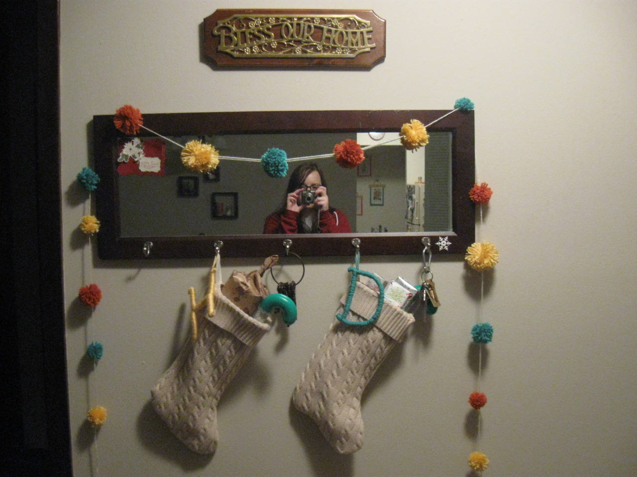 My holiday yarn garland & stockings made out of thrift store sweaters!