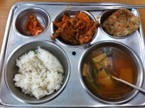 Clockwise from top left: kimchi; chicken jjim; ground-beef and garlic-chive pancake; soup with squares of fish cake, mushrooms and leeks; rice. I don't know why this picture turned out so terribly.