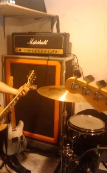 tovegantinued:  Random photo of a corner of Reviver's first practice space. Studio 17 at Positively 4th Street. I'll try to find more pictures to point out how big of a bullshit room it was. It was tiny and there were diagonal pillars running through it.