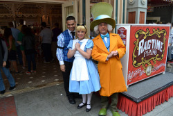 Alice and the Mad Hatter (and Alan the Ragtime Piano Player) Taken on May 14, 2011 at the Corner Cafe on Main Street USA, Disneyland (Disneyland Resort, Anaheim, CA) Photo by Loren R. Javier.  This photo can be republished for non-commercial purposes, but only if it contains photo credit and/or link back to the original photo.  Please click photo for rules on the Creative Commons license of this photo.