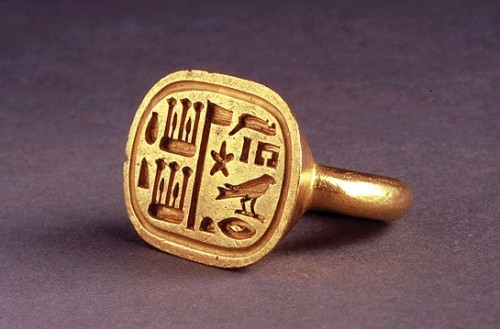 black-culture:  elhieroglyph:  Ancient Egyptian GOLD RING OF SHESHONQ 26th Dynasty, 6th Century BC  This heavy gold ring of the priestly official, Sheshonq, is a stirrup shaped signet. This type of ring was developed from the rigid-bezel ring of the Middle Kingdom. The lozenge shaped bezel is incised with the name and titles of the owner, which included the office of Chief Steward. The bezel could be pressed into hot wax to seal documents and letters. Besides this functional aspect, the ring was no doubt worn as a mark of Sheshonq's status and wealth. The name 'Sheshonq' is of Libyan origin, belonging to several kings of the Libyan Period, but became popular among Egyptians from that time onwards.