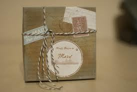 Place cards and wedding favors all in one. They look like little care packages!!!