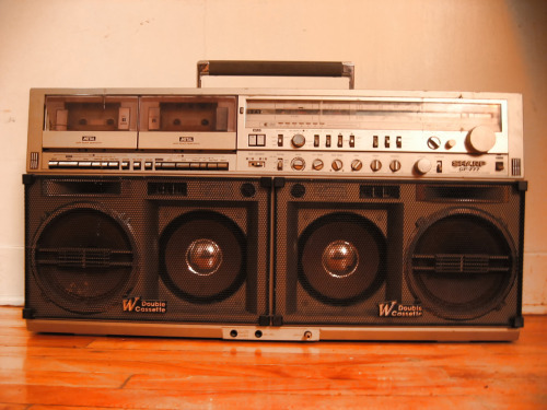 The BOSS of BOOMBOXES : The revered Sanyo GF-777, belongs to one of my best friend. If you know about boomboxes, you know that this is like the top one with another model.. the biggest baddest of them all…..  when we was kid, we use to take turns carrying it around to go break in the park… So heavy, but loud!  I heard stories that Notorious B.I.G use to dream of getting one of those when he was young!