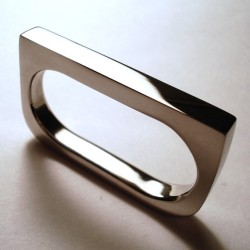 I like this clean, simple two-finger ring. Great lines. Available from: Etsy