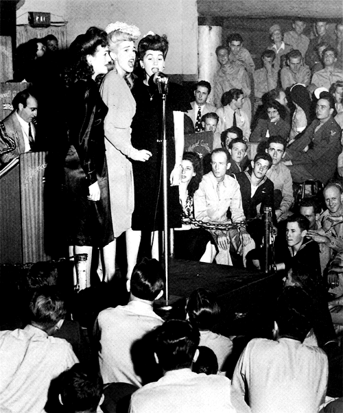 herekitty:  The Andrew Sisters perform at the Hollywood Canteen in the early 1940s.