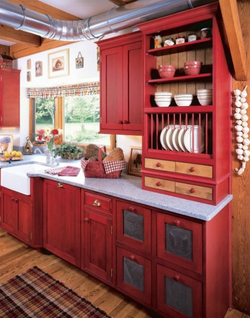 A sweet and charming rustic country kitchen with red distressed-painted cabinets (via  Kleppinger Design Group, Inc.)