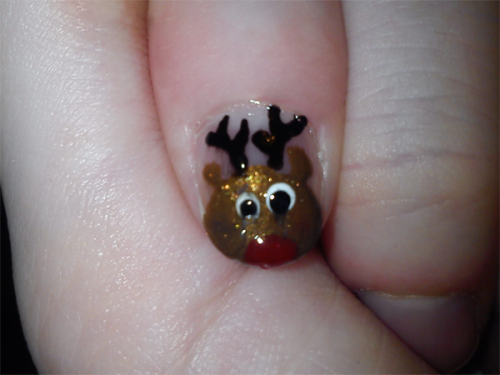 More in the winter nail art department - a (slightly drunken!) reindeer I did on myself, and some glittery snowy snowmen on my sister. Sorry about the appalling cleanup job, and the rubbishy photos.