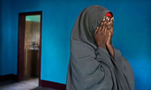 "inothernews:  A rape victim in Mogadishu.  From the New York Times, a sickening story of the alarming rise in sexual assaults against women and girls in war- and famine-torn Somalia:  Somalia has been steadily worn down by decades of conflict and chaos,  its cities in ruins and its people starving. Just this year, tens of  thousands have died from famine, with countless others cut down in  relentless combat. Now Somalis face yet another widespread terror: an  alarming increase in rapes and sexual abuse of women and girls.   The Shabab militant group, which presents itself as a morally righteous  rebel force and the defender of pure Islam, is seizing women and girls  as spoils of war, gang-raping and abusing them as part of its reign of  terror in southern Somalia, according to victims, aid workers and United Nations officials. Short of cash and losing ground, the militants are also  forcing families to hand over girls for arranged marriages that often  last no more than a few weeks and are essentially sexual slavery, a  cheap way to bolster their ranks' flagging morale.   But it is not just the Shabab. In the past few months, aid workers and  victims say, there has been a free-for-all of armed men preying upon  women and girls displaced by Somalia's famine, who often trek hundreds  of miles searching for food and end up in crowded, lawless refugee camps  where Islamist militants, rogue militiamen and even government soldiers  rape, rob and kill with impunity.   With the famine putting hundreds of thousands of women on the move —  severing them from their traditional protection mechanism, the clan —  aid workers say more Somali women are being raped right now than at any  time in recent memory. In some areas, they say, women are being used as  chits at roadblocks, surrendered to the gunmen staffing the barrier in  the road so that a group of desperate refugees can pass.   ""The situation is intensifying,"" said Radhika Coomaraswamy, the United  Nations' special representative for children and armed conflict. All the  recent flight has created a surge in opportunistic rapes, she said, and  ""for the Shabab, forced marriage is another aspect they are using to  control the population.""   (Photo: Sven Torfinn / The New York Times)"