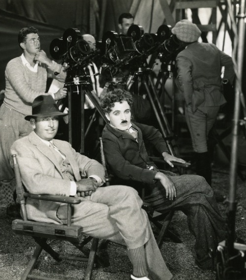 Douglas Fairbanks & Charles Chaplin on the set of The Gold Rush (1925, dir. Charles Chaplin) (via)