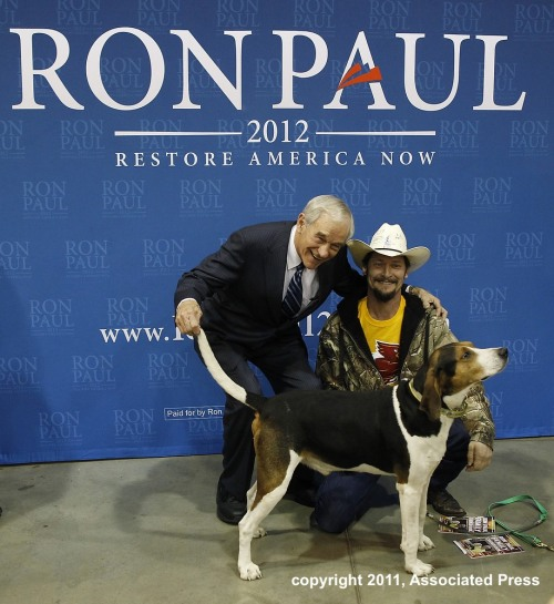 crouchingthaiguy:  Ron Paul, a supporter, and his dog at a campaign event in Des Moines, Iowa. (AP Photo/Charles Dharapak) #caucus  AMAZING.