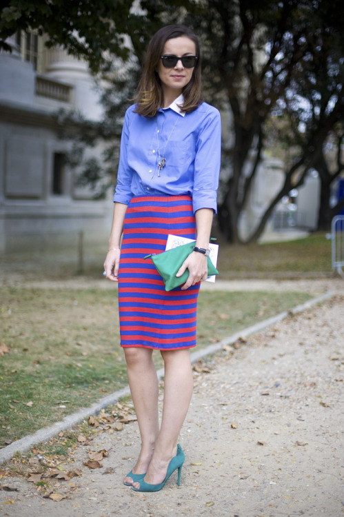 Striped skirt with preppy shirt in Paris.