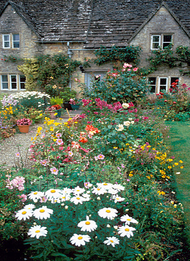 bewitchingbritain:      Okay even for the Cotswolds this is ridiculously beautiful. Did you notice there are shutters missing and a windowpane or two, yet the garden is flourishing with attention? A barefoot gypsy lady wearing an orange silk tea-gown lives here, and she has her priorities in order. (photographer Dave Porter)