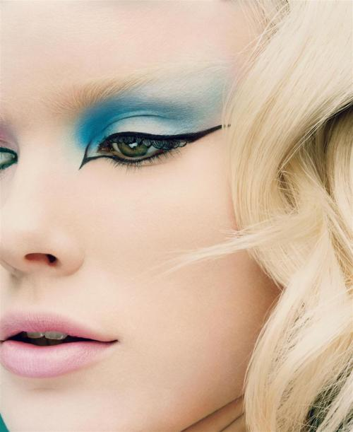 Absolutely Amazing Eye liner and Matte Pastel Makeup —- Totally gorgeous; I don't have anything else to say about it. The play between lighting, contours, expert blending of matte pastel shades, the model's coloring, and precise textures just brings out the liquid liner all the more. The overall effect is dreamy and almost doll-like, but extremely edgy at the same time, and not at all frou-frou. [Source: Harper's Bazaar June 2003, via eyeshadowlipstick.com]