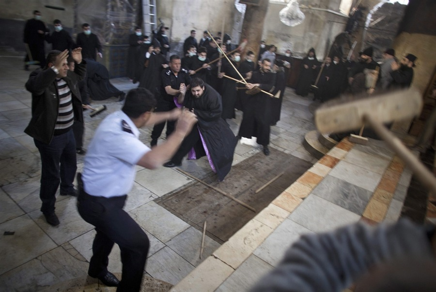 peace—now:  Dec. 28: Armenian and Greek Orthodox clergy and police scuffle and beat each other with brooms during the annual cleaning of the Church of the Nativity in the West Bank city of Bethlehem.  Every year, members of the two sects, along with parishioners and laypeople, clean the church. The Armenians and Greek Orthodox are always extra careful not to cross into each other's territory, but this year they started arguing about stepping into each other's areas, and began hitting each other with brooms. Palestinian police had to come between them.   (Photo by Oliver Weiken, European Pressphoto Agency)
