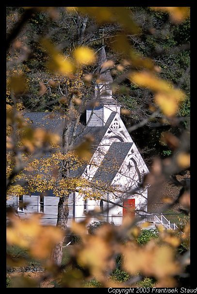 St. Bridget Church in West Cornwall viewed through autumnal foliage, Connecticut