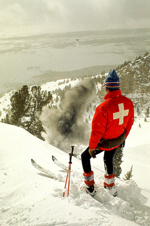 reclaimedlight:  Jackson Hole, WY. c 1970. Another ski patrol BOOM! Getting ride of avalanches.
