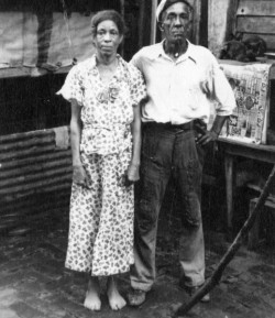 "afrodiaspores:  ""Voodoo queen Lala and her husband Louie in New Orleans Louisiana in the 1930s,"" photographer and exact date unknown  Al Rose, in Storyville, writes that ""an association of [the red light district] Storyville madams, which met regularly, agreed to refuse to use the services of Lala and other [Voodoo] practitioners on each other."" The favorite queen of the madams was Eulalie Echo. They were always requesting her services for cures and hexes. Her real name was Laura Hunter, and she raised Jelly Roll Morton. She was his godmother… In the late 1970s Irma Thomas, the New Orleans singer, would record a tune called ""Princess Lala""—based on Lala, a famous Voodoo queen in the New Orleans of the 1930s and 1940s—with by all accounts a fairly accurate Voodoo practice  described in the lyric.   Robert Tallant wrote in 1946,  If there is a living successor to [Marie Laveau's] Voodoo throne it is probably Lala…""I've had plenty trouble,"" Lala admitted. ""I been pulled in lots of times, but they can't do me nothin'. One time I told a judge to give me his ring and I'd make it walk. When he seen his ring walkin' away he said, 'You is sure a smart woman.' Then he let me go. You see, I been studyin' all my life…"""