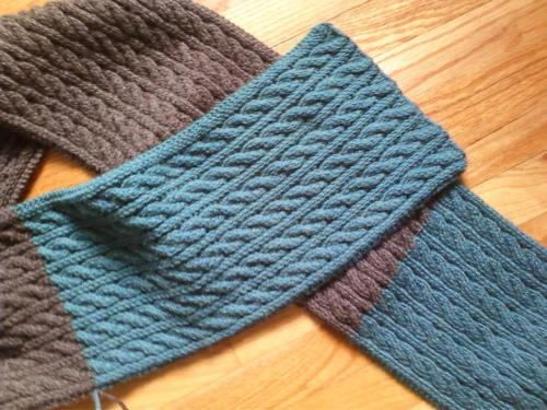 sheepysheepysoay:  This is an epic scarf. It is a simple cable pattern however it is six feet and four inches tall. I finnished this last winter.