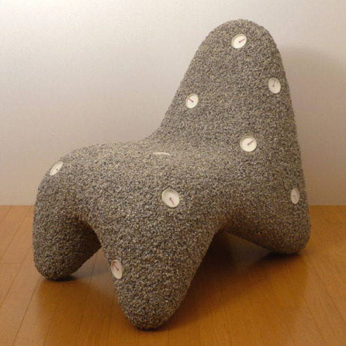 Eternal Stone Chair by Shinobu Koizumi - made of granite and epoxy resin with sixteen glow-in-the-dark timepieces
