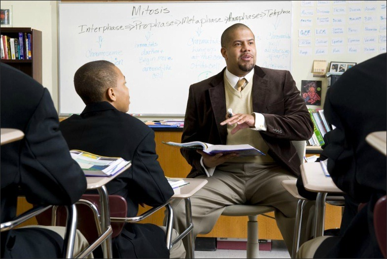 Professor in a classroom at Urban Prep in Chicago.