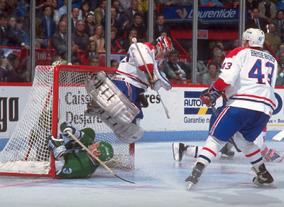 siphotos:  Patrick Roy jumps to avoid a sliding Zarley Zalapski during Game 7 of the their 1992 first-round series. Montreal would go onto win the series, 4-3, but would lose in the next round to Boston. (David E. Klutho/SI)