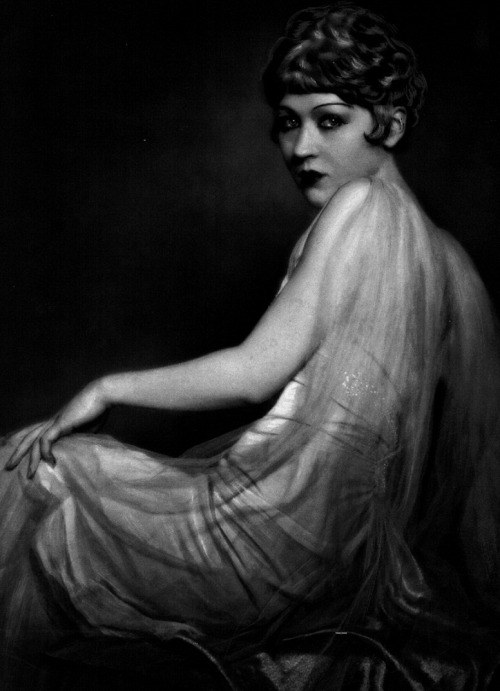 "Catherine Hessling in publicity still for Nana (1926, dir. Jean Renoir) (via) ""She is a girl descended from four or five generations of drunkards, her blood tainted by an accumulated inheritance of poverty and drink, which in her case had taken the form of a nervous derangement of the sexual instinct. She had grown up in the slums, in the gutters of Paris; and now, tall and beautiful, and as well made as a plant nurtured on a dungheap, she was avenging the paupers and outcasts of whom she was the product. With her, the rottenness that was allowed to ferment among the lower classes was rising to the surface and rotting the aristocracy. She had become a force of nature, a ferment of destruction, unwittingly corrupting and disorganizing Paris between her snow-white thighs."" -Emile Zola, Nana (1880)"