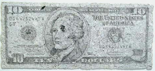 The 9/11 Commission Report transformed into a ten dollar bill.