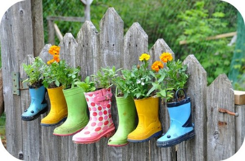 Cute! fuckyeahupcycle:  #Upcycled rain boot planters.