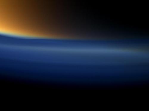 Orange and Blue Hazes This view from NASA's Cassini spacecraft looks toward the south polar region of Saturn's largest moon, Titan, and shows a depression within the moon's orange and blue haze layers near the south pole.The moon's high altitude haze layer appears blue here; whereas, the main atmospheric haze is orange. The difference in color could be due to particle size of the haze. The blue haze likely consists of smaller particles than the orange haze.The depressed or attenuated layer appears in the transition area between the orange and blue hazes about a third of the way in from the left edge of the narrow-angle image. The moon's south pole is in the upper right of this image. This view suggests Titan's north polar vortex, or hood, is beginning to flip from north to south.The southern pole of Titan is going into darkness as the sun advances towards the north with each passing day. The upper layer of Titan's hazes is still illuminated by sunlight.Images taken using red, green and blue spectral filters were combined to create this natural color view. The images were obtained on Sept. 11, 2011 at a distance of approximately 83,000 miles (134,000 kilometers) from Titan. Image scale is 2,581 feet (787 meters) per pixel.Image Credit: NASA/JPL-Caltech/Space Science Institute