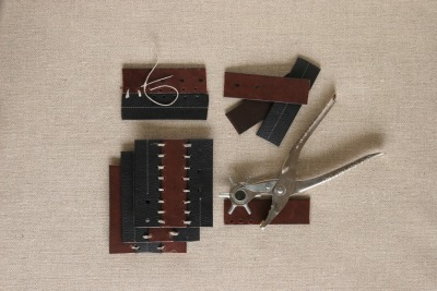 DIY project du jour:  Upcycle old belts into coasters. On the Daily Danny blog, Danny Seo describes three simple how-to steps: Cut belts into strips.  Punch holes along the edges. (A leather cutter or an awl could be used.)  Bind strips together with twine. This project is a great addition to Unconsumption's series of posts on new uses for old belts, which includes an earlier upcycling project of Danny's. [Thanks, Danny!]