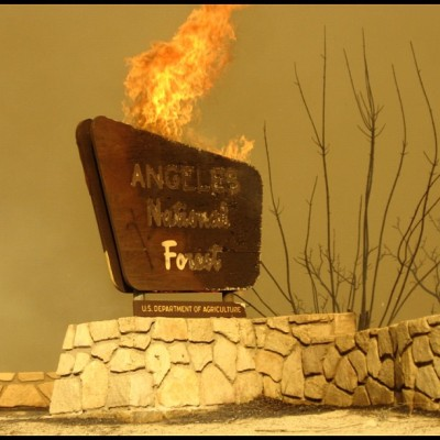 ericiam:  Angeles National Forest Sign on fire during the Station Fire. (Taken with instagram)  Yikes.