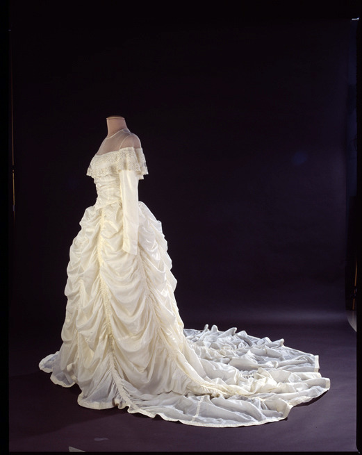 Image description: This wedding dress was made from a nylon parachute that saved Major Claude Hensinger during World War II.  Hensinger, a B-29 pilot, and his crew, were returning from a bombing raid over Yowata, Japan, in August 1944 when their engine caught fire. The crew was forced to bail out. He kept the parachute and used it to propose to his girlfriend Ruth in 1947. Learn more about the story behind this parachute wedding dress. Photo from the Smithsonian's National Museum of American History