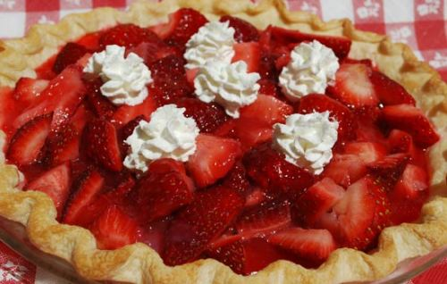recipe-file:  sweetthingconfectionery:  The Easiest Strawberry Pie I debated for a while about whether or not I could put this on the blog because it's so simple, I can't really call it baking. But in the end I caved. Enjoy! Ingredients ·         Strawberries (about a quart, I used around two packages) ·         ¼ cup sugar (more or less depending on how sweet you like it) ·         ½ cup water ·         3 tbsp cornstarch ·         Pre-baked pie shell Directions 1.       Mash one quarter of the strawberries, and cut the other three quarters into slices, combine in a bowl. Add sugar, and put on the stove to boil. 2.       Combine the water and the cornstarch in a separate bowl. 3.       When the strawberries are boiling gently, add the cornstarch mixture and stir. Stir constantly for about 5 minutes (or until it has the consistency of honey). 4.       Let cool for a couple minutes, and then pour into your pie shell. Carefully (really carefully! I know..) put your pie in the fridge to cool for a minimum of an hour. Happy baking! The Cupcake Queen  YUM!  Next on the list