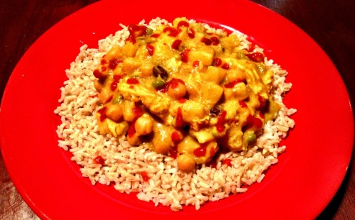"Sweet Curry! Banana, pineapple, raisins, ""chicken,"" green and chick peas over brown rice. I found a recipe for Banana Curry from Death By Curry (who's site looks like it came from Angelfire circa 1995) and modified it some. 1 package of Gardein Chick'n Strips, Morningstar Meal Starters Chick'n Strips or you can use drained and cubed extra-firm tofu 1 can coconut milk  3 large or 4 medium bananas, split and cut into chunks  1/4 cup dried shredded coconut  1/2 cup raisins  2 tbs. curry powder  1 tsp. cumin  3/4 tsp. nutmeg  2 tbs. crushed red pepper 2 tbs. Sambal Oelek  1 20 oz. can pineapple tidbits 1 14 oz. green peas  1 14 oz. can chick peas  (optional) 1 14 oz. can straw mushrooms, drained.  (optional) 1/4 cup cashews Add the coconut milk over medium high heat then add and stir in the spices and sambal oelek. Add the rest of the ingredients except the bananas. Bring to a boil and then turn the heat down to low, add the bananas and cook for about 5 more minutes. Serve over rice and enjoy."