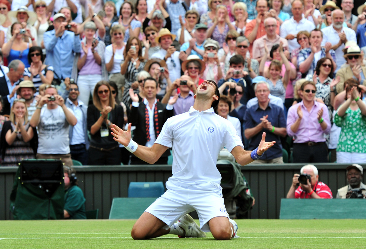 2011 in Sport: The rise of DjokovicThe Shot was more a result of destiny than luck. Much as 2010 had been about crowning Rafael Nadal the new King of Tennis, 2011 represented the Rise of the Joker.Novak Djokovic, who was often thought of as the third wheel, went 6-0 against Nadal (all their matches came in tournament finals) and 4-1 against Roger Federer. But what silenced any critic who dared to suggest that Djokovic was not mentally or physically strong enough to be the world No. 1, was his endurance. For four straight months, he was unbeatable.Photo: Leon Neal/AFP/Getty ImagesRelated: 2011 in Sport: Three more tennis moments to remember2011 in Sport: The best tennis photos of the yearRead more from our 2011 in Sport series
