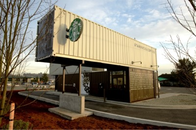 The Starbucks container store we posted about while under construction a few weeks ago finally opened on December 13 in a suburb south of Seattle. The new drive-thru location was built to LEED standards and is awaiting certification. Its built with three containers and implements rainwater harvesting, xeriscaping and reduced signage. If only it weren't a drive-thru.  [via Dear Coffee, I Love You]