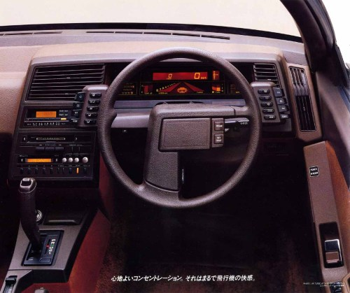 "Driving the Subaru XT was like playing a 1980s-era arcade game. Demo.  The inside of the car had many aircraft-like features such as pod mounted lighting, climate control and wiper controls. The standard tilting-telescoping steering moved the instrument panel to keep it lined up with the steering column when tilting. The shifter was joystick-shaped and had a thumb trigger interlock and ""on-demand"" four-wheel drive button. Turbo models featured a sort of artificial horizon orange backlit liquid crystal instrument display with the tachometer, boost indicator, temperature and fuel gauges seen as three-dimensional graphs tilting back out to the horizon. Demonstration of Subaru XT digital instrumentation The aircraft cockpit approach reflected influences from Subaru's parent company Fuji Heavy Industries, which also manufactured aircraft, such as the Fuji FA200 Aero Subaru. The XT was loaded with features rarely found on small cars, such as a turbocharger, a computer-controlled engine and transmission, adjustable height suspension[1] and an optional digital instrument cluster. The air suspension was inspired by various manufacturers who used Hydropneumatic suspension, such as Citroen, and Mercedes-Benz. The XT also had some features found on few other cars, such as an electronic in-dash trip computer, retractable flaps covering the door handles, and a single wiper blade for the entire windscreen. Pass-through folding rear seats and racing style front seats were standard equipment.  (image via Product Design Data Base)"