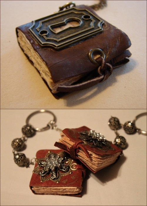 "craftdiscoveries:  DIY Mini Book Necklaces with Charms. I have posted 3 or 4 mini book jewelry tutorials and I keep saying, ""Oh, this is the best one."" But this is my favorite. Clear instructions, love the grommet closures tied with leather, love the keyhole. For the tutorial and other ideas go to Art by Wendy here. I got a GC to Michaels and will get a crop-a-dile using coupons of course."
