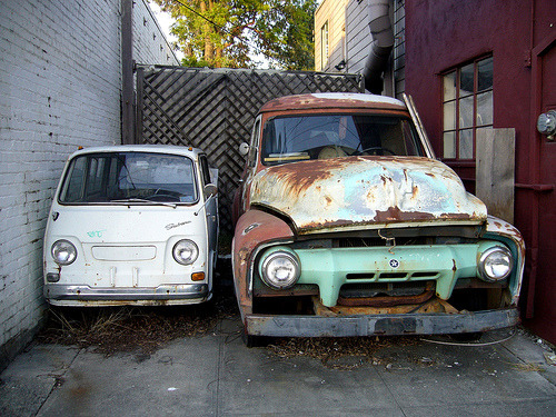 Subaru Sambar and American (GMC?) pickup truck. A few years ago I spotted these two friends in my Oakland neighborhood. I so wanted to put that little Sambar in my pocket, but all I could take were a few photos. My shot of the lovely chrome badge ended up in a variety of Subaru newspaper ads and online promotions.