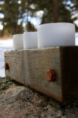 15″ x 3 1/2″  Holds three 3″ pillar candles.  Made with reclaimed deck posts and mining bolts. *Available in many candle sizes. $30