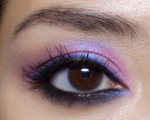 "Easy Weekend Eye: Pink-Violet Duochrome [MAC Stars n Rockets and Flashtrack shadows] —- Pink and Purple are right up there in many ""Favorites"" lists when it comes to makeup colors. But what about Purple-in-Pink? This look features a bright magenta pink with a violet-blue duochrome shift. I'm not sure about you but I find this color to be just a little too dramatic and reminiscent of the 80's on most days, so I seldom touch it. But when you temper it with a little blue and black at the lash lines, and heaps of blending, the overall effect can be quite modern and smoldering even. I used an old mica from I Nuovi called Amethyst (I believe they discontinued this in their Dust collection), but this is not a hard color to find. Urban Decay Deluxe Shadow in Fishnet and MAC Stars n Rockets are pretty much identical to this. The other 2 key componenets to this look are a strong, creamy black kohl or kajal, and navy blue shadow (I used MAC Flashtrack but any shimmery deep navy will do equally well. —- Step 1: Apply the black gel or kohl liner (I used The Body Shops' Special Edition Kajal Eyeliner - they really need to make this permanent) very thickly to the upper and lower lash lines. Don't worry about getting it neat as it will be covered over later. Just make sure it is very black, very dense, and quite thick. You will likely need to reapply after you're done with your eye shadows.  —- Step 2: Run a deep navy blue shimmer along the lower lash line to get a smoky finish. Do not apply the blue shadow to the water line. You want to keep the liner very black there.  —- Step 3: Pack the star of the show, a bright duochrome magenta to the lids, up just past the socket line. As the pink goes over the black liner from earlier, it'll transform into a lovely dark blue sheen.   —- Step 4: Dab your brush into a blend of both the magenta duochrome and the navy shade from earlier, and very lightly buff it along the outermost section of your socket line to add a bit of depth and contour. At this point, you may want to touch up the black kohl or liner along the water line, as it would probably have shifted and faded a little. (A second layer also helps to keep it on better.)  —- Step 5: Finish with lashings of black mascara. I wanted to keep everything still looking smoldering by keeping all the darkness just to the inner rims of the eyes, so I skipped false lashes here, but if you really want to go to town with this, you can definitely pop on falsies."