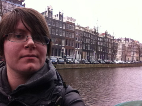The only photo of me taken on my trip. In amsterdam, in front of buildings. We spent most of our time there checking out the real estate….