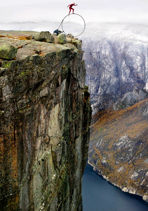 "alecshao:  Extreme balancing artist Eskil Ronningsbakken on the edge of a cliff 1,000 feet high in Norway: ""It's the balance between life and death, and that's where life is."""