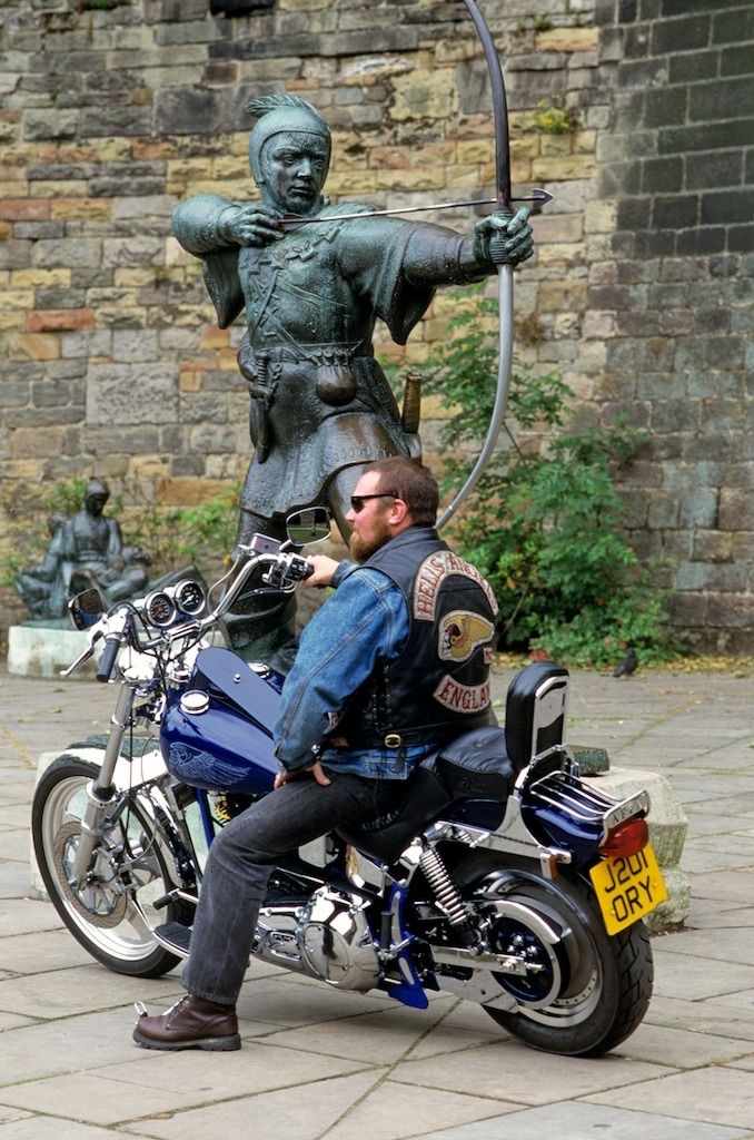 Member of Ashfield HAMC in front of a statue of Robin Hood in Nottingham. Two 1%ers from different eras. I shot this for Live To Ride UK magazine.