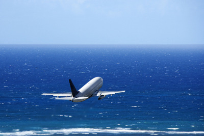 Airplane over ocean. by The-Lane-Team on Flickr.