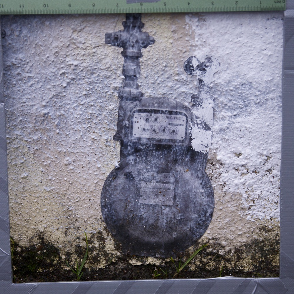 Gas meter art decal on side of building just off NE Alberta St. The whole rest of this wall had been painted over carelessly with white paint, presumably to cover up some large graffiti (and there was fresh large graffiti on that coat of white paint, go figure), but this little maybe foot and a half square had been left alone so that the fake gas meter could remain visible. It was striking from across the street, where it wasn't immediately clear that the meter was fake but the lack of depth at that distance was just enough to register as wrong to my brain.  Nice little bit of banal surrealism.