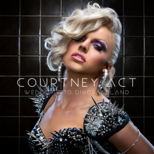 "Courtney Act, a pun on the phrase ""caught in the act"", is the stage name of ""gender illusionist"" Shane Jenek, an Australian drag celebrity, pop singer and entertainer. Jenek auditioned for Australian Idol as himself but did not get beyond the selection auditions. Returning the next day as Courtney, he wowed the judges. As Courtney Act, Jenek was a semi-finalist on Australian Idol in 2003. Revealing impressive voice and singing talents as well as a stage presence considerably ahead of many of the other contestants, he continued until being finally voted off in thirteenth place. Shane particularly impressed judge Ian ""Dicko"" Dickson, who signed him to the BMG label following the completion of the show. He was the third singer of the competition to release an official solo single. The single, ""Rub Me Wrong"", was released in 2004, which peaked at #29 on the ARIA Singles Chart. Jenek is a native of Brisbane, but he lives in Sydney."
