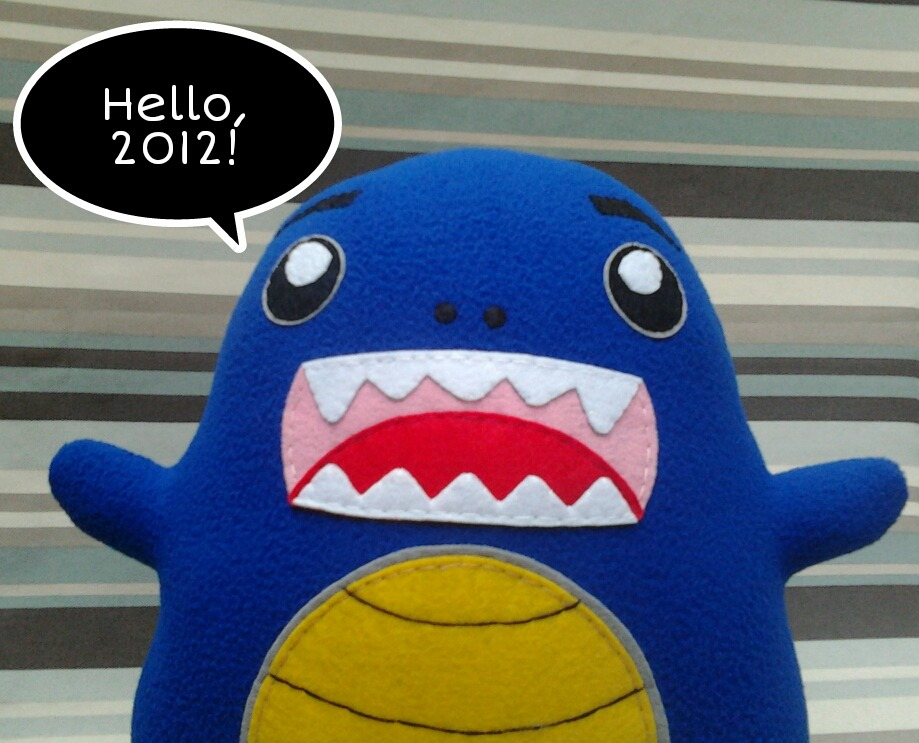 Meet Max! The last monster plushie we made before 2012. We'd like to thank all of our clients, fellow artists, collaborators, followers, friends and supporters for this super awesome year. May we all have more rockin' years to come. Hello, 2012. Be kind to us. More plushies to be created! :)